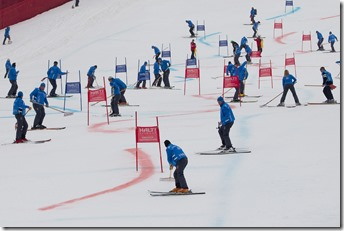 Course workers repair the piste between runs at the team event a parallel slalom race at the 2011 Alpine skiing World Championships